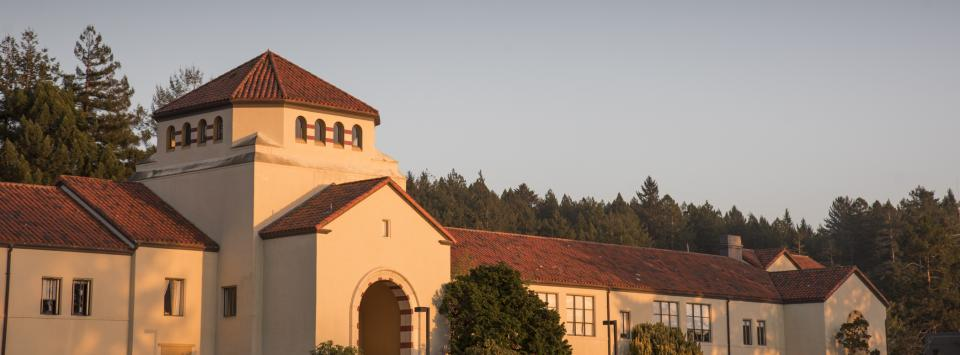 a building - founders hall at dusk