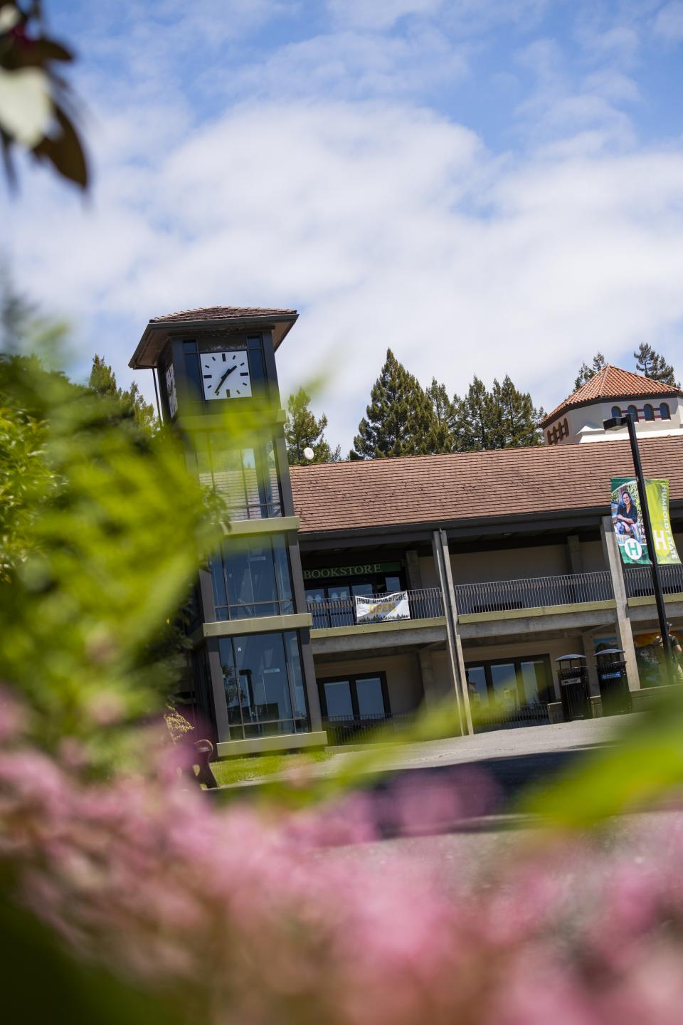 campus clock tower and book store