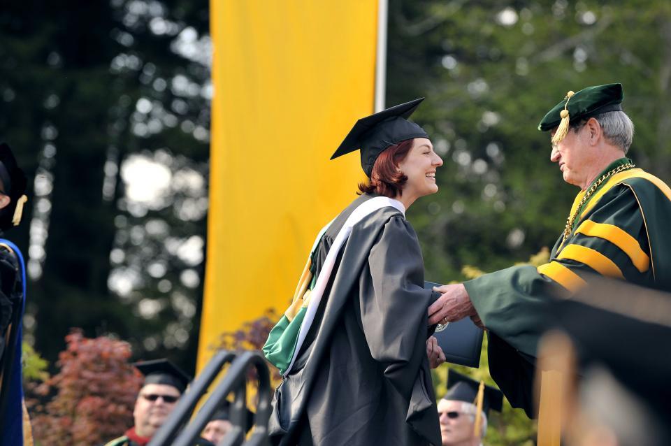 graduate student receiving her diploma